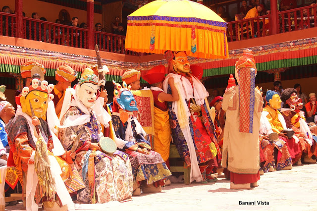 GUru Padmasambhava in the middle under the umbrella