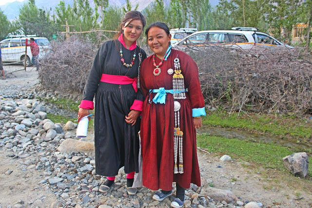 In their traditional dress