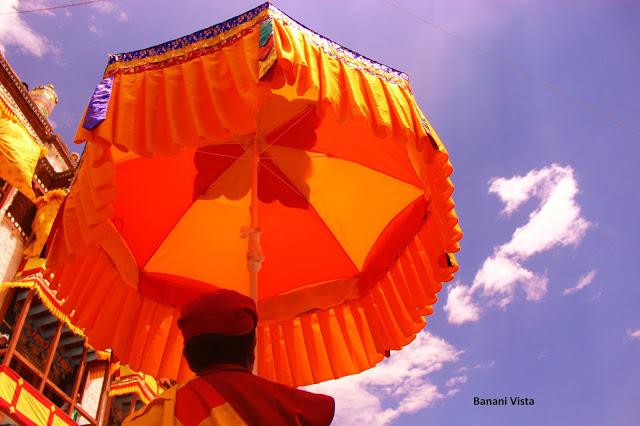 A man holding an umbrella for Guru Padmasambhava