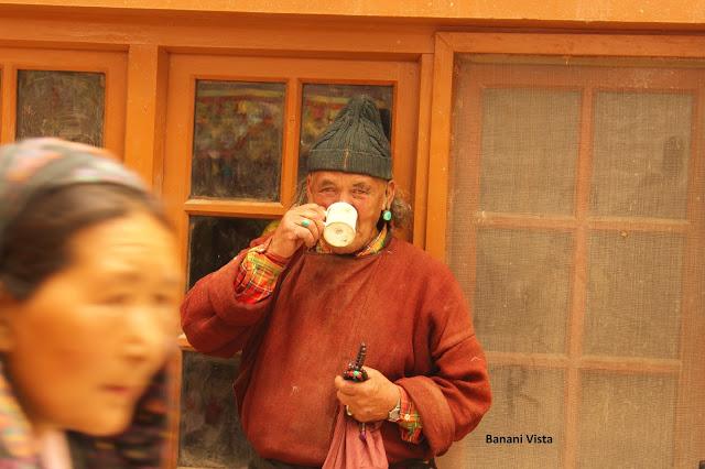 A pilgrim drinking butter tea