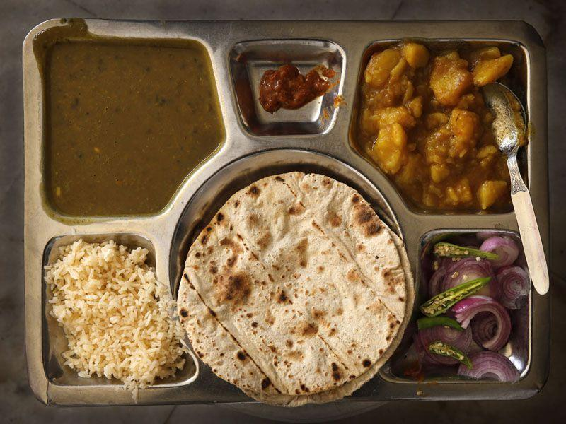 The Langar thali comprising of rice, roti, dal, and a vegetable dish