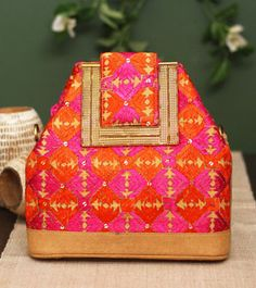A handbag with Phulkari