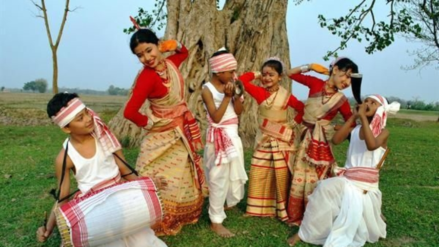 Bihu dancers and singers welcome the spring