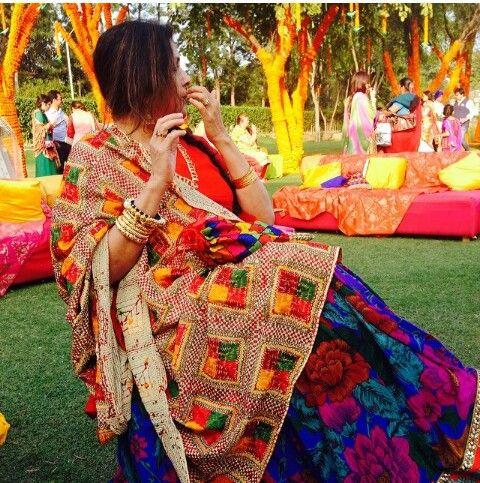 A lady wearing a Phulkari dupatta