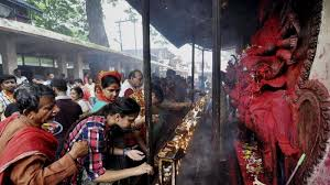 Devotees perform puja at the temple