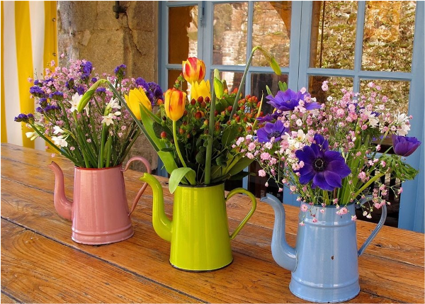 Watering Cans as Flower Pots