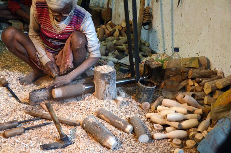 Skilled craftsmen work hard to make these toys