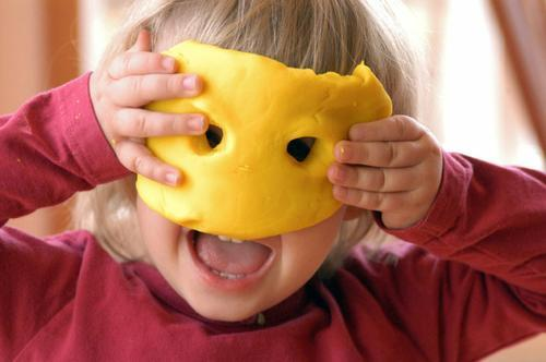 Toddler having fun with dough