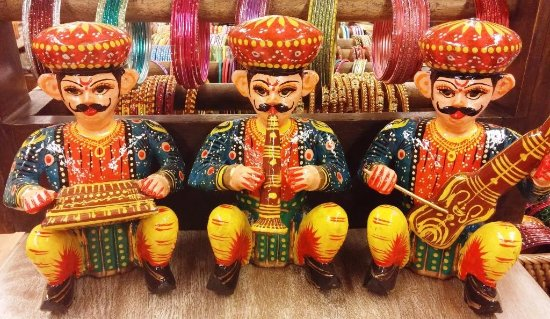 Wooden handicrafts depict village life