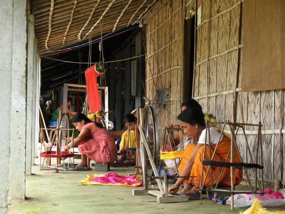 Bodo women engaged in the weaving process image courtesy: www.thealternative.in
