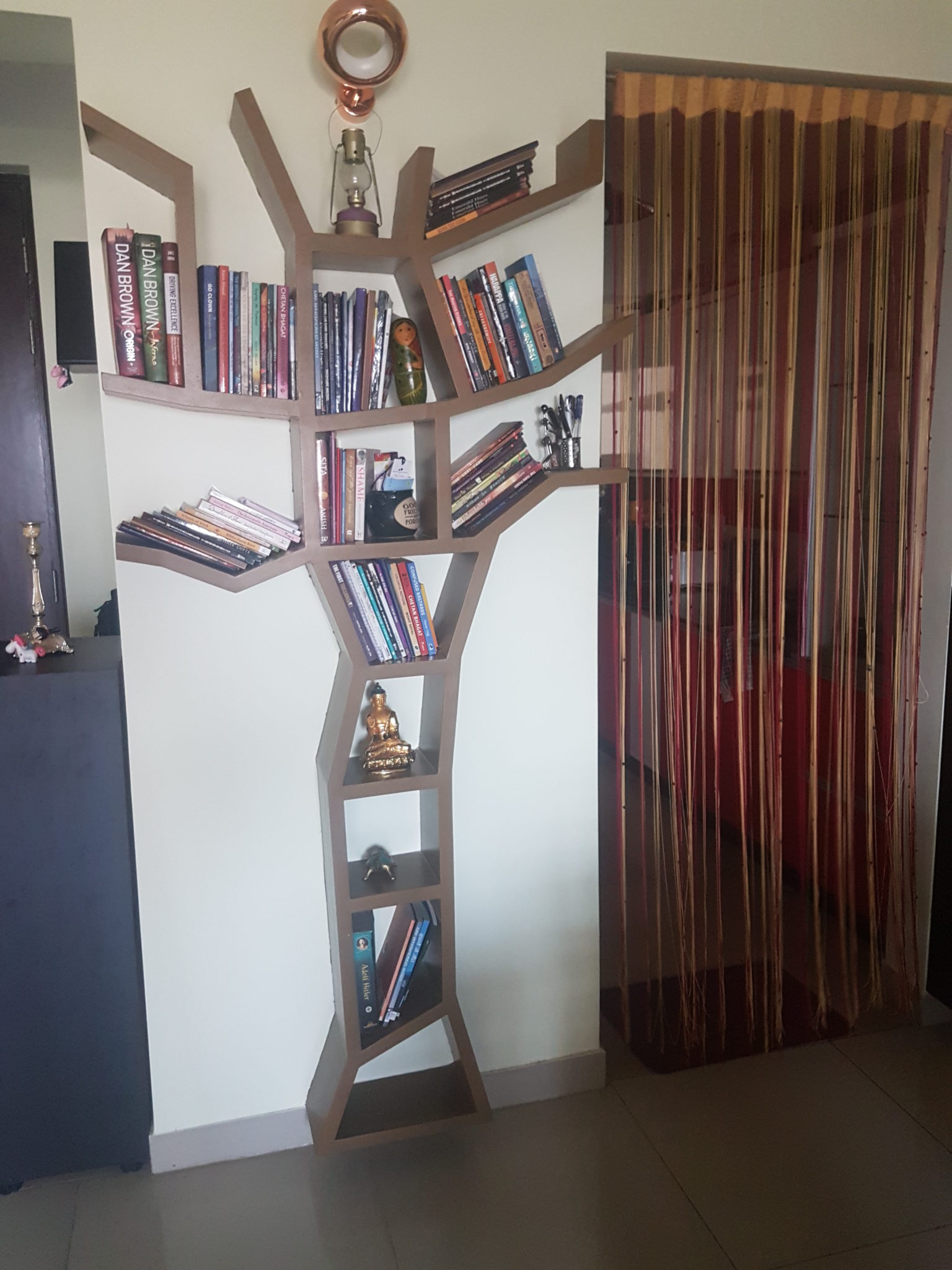Tree Bookshelf and Branch Bookshelf on opposite walls