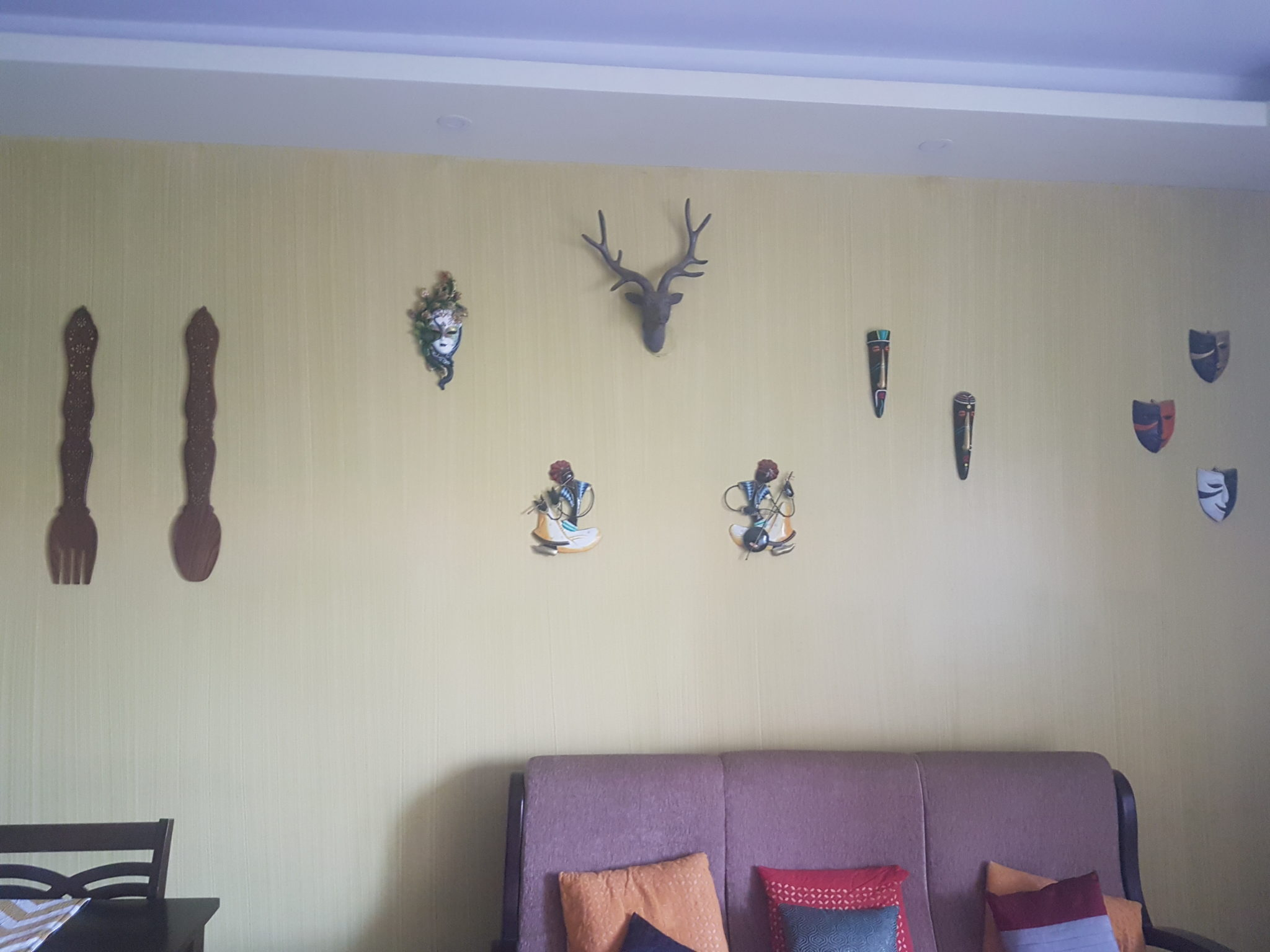 Mask themed wall in drawing room