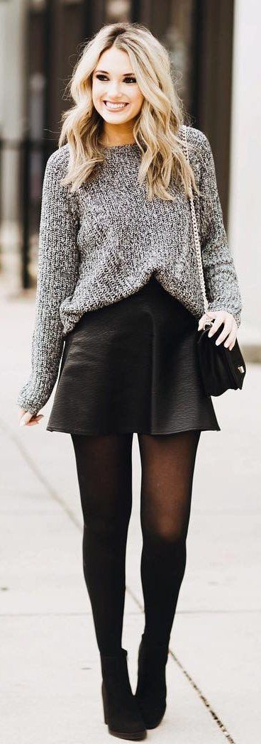 Mini skirt with comfortable sweater paired up with stockings