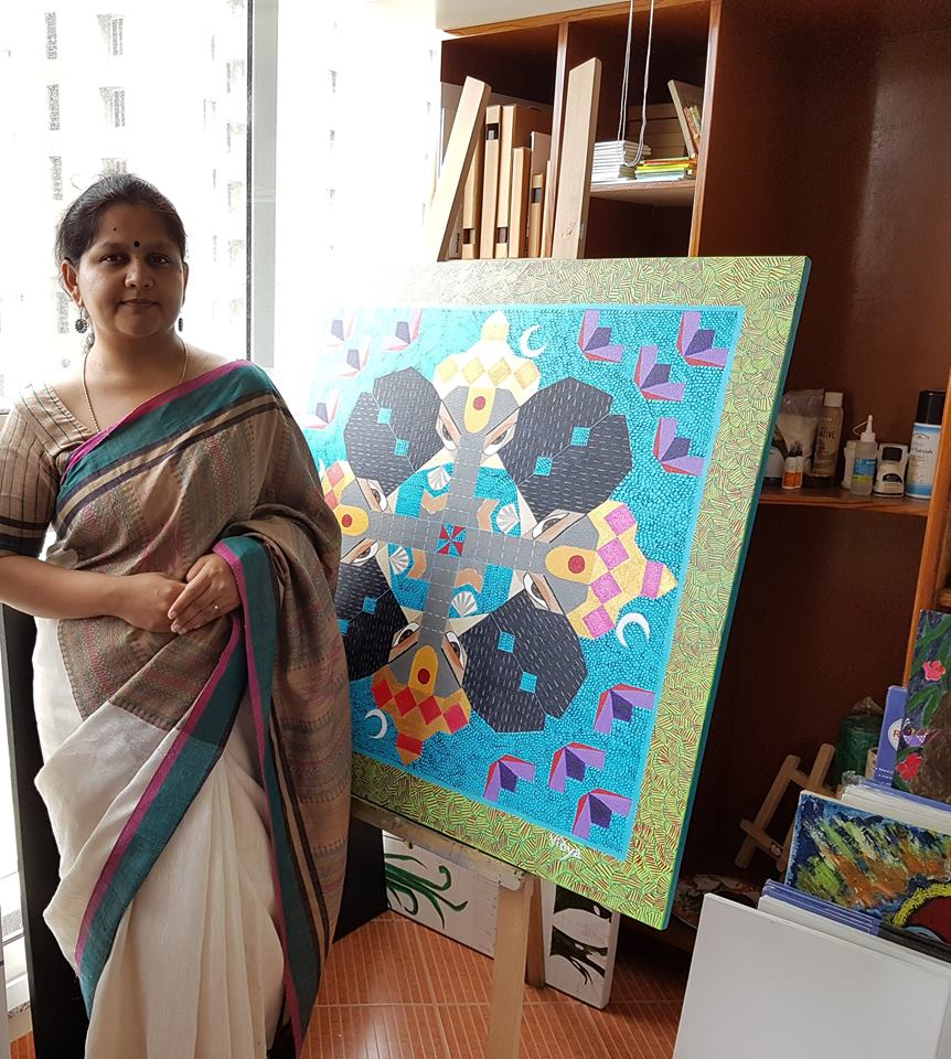 With one of the paintings from her 'Daivik' series