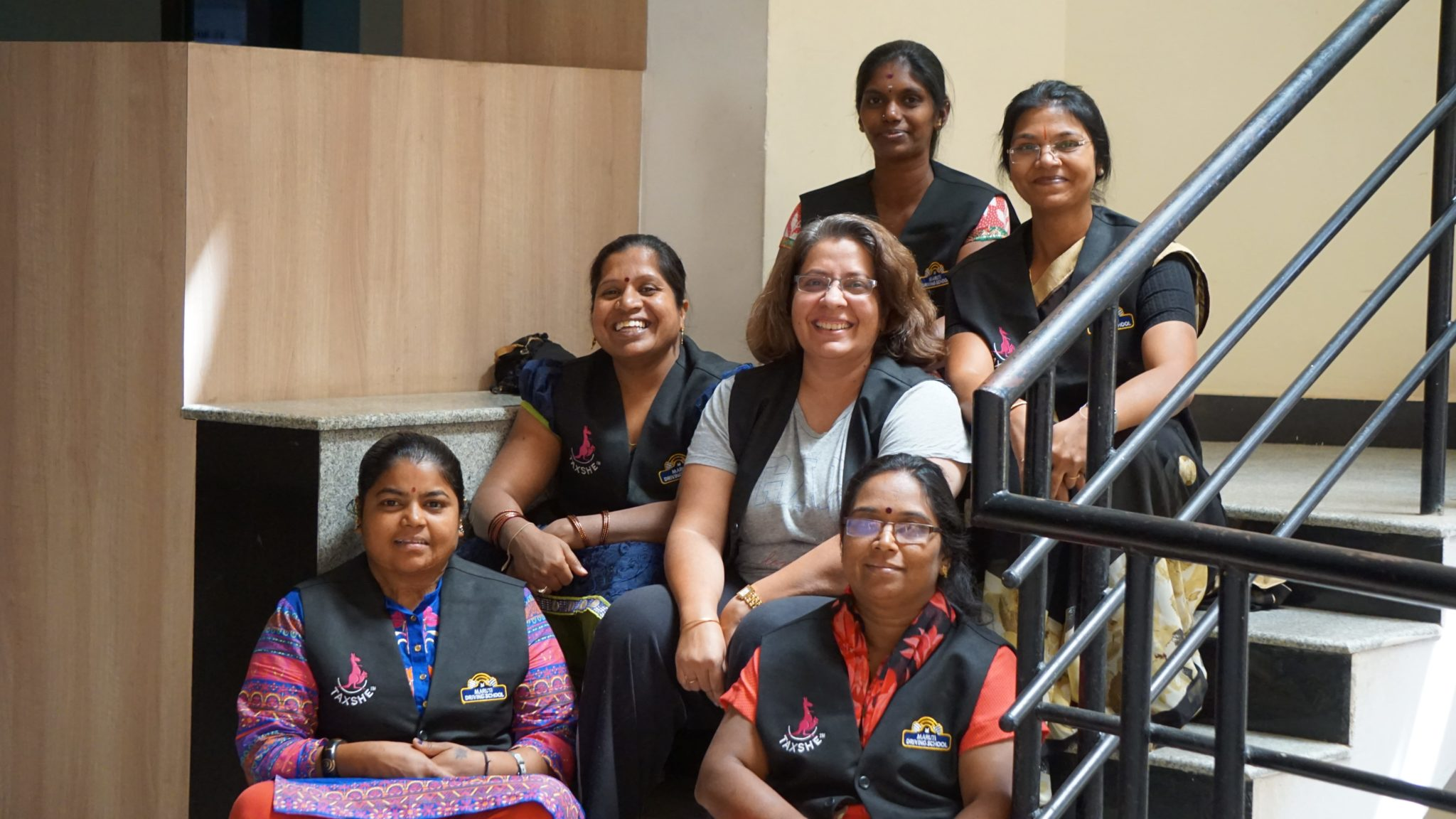 Vandana with her fleet of women drivers