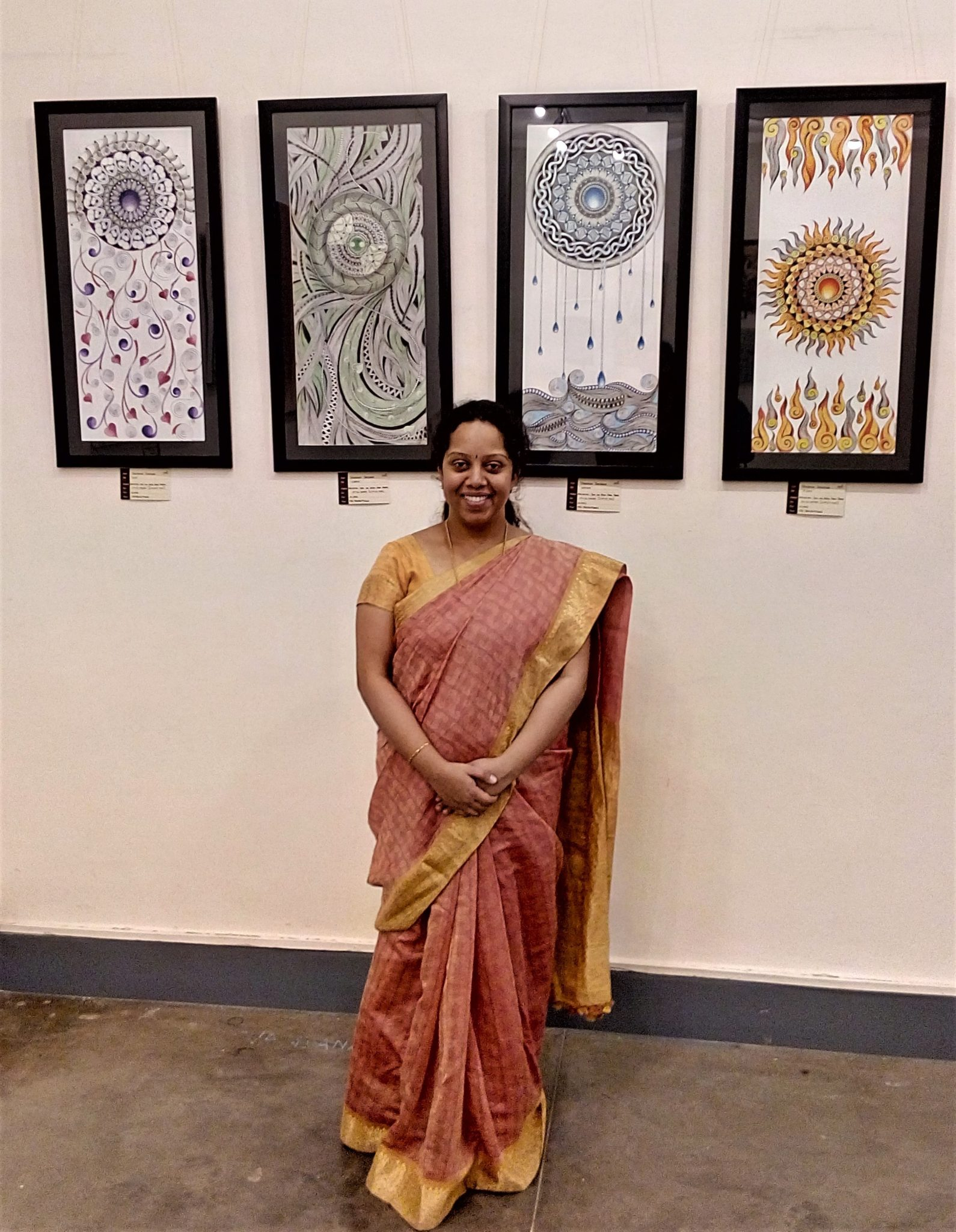 Vandana Krishna with her abstract artwork