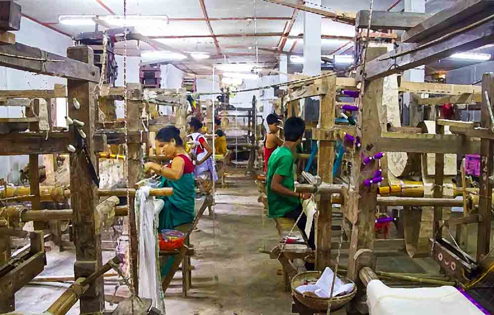 Weavers at work in Sualkuchi