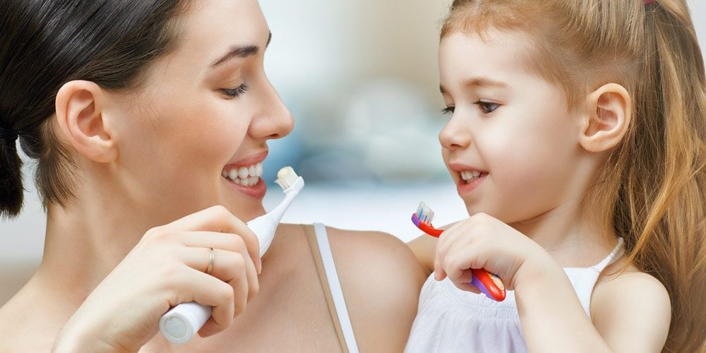 Teach brushing to your kids