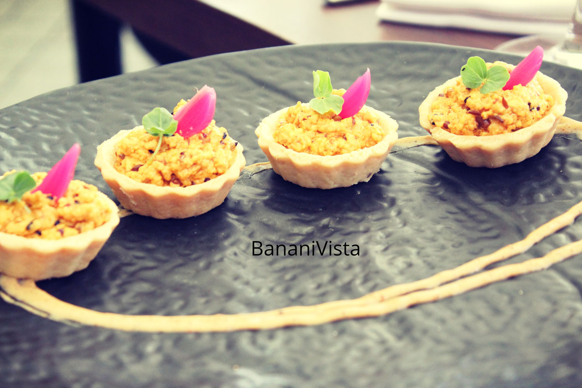 Panch Phoran paneer bhurji tart served with New pickle onion, Farzi Cafe