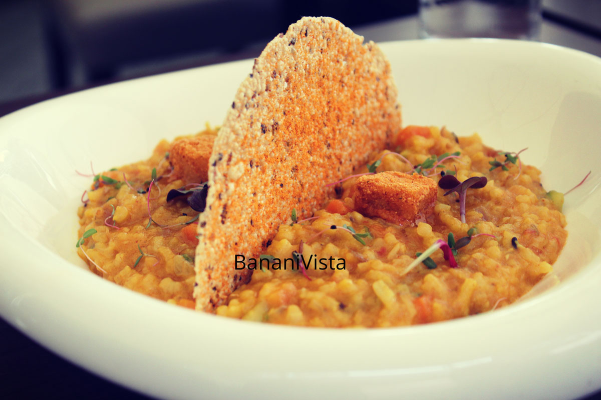 Dal Khichdi risotto, Papad crisp, Achari butter, Farzi cafe
